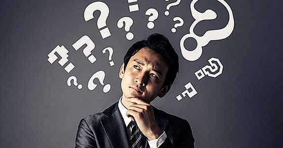 man with question marks above head